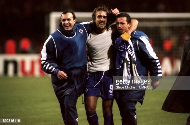 Fiorentina striker Gabriel Batistuta celebrates victory at the end of the final whistle flanked by his team mates Abel Balbo and Predrag Mijatovic