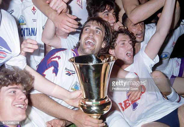 Fiorentina striker Gabriel Batistuta with the trophy as his team mates celebrate their victory over Atalanta in the Coppa Italia after the 2nd Leg of...