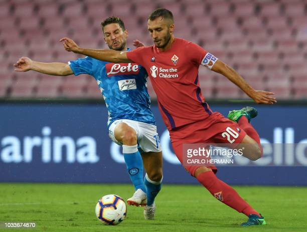 Fiorentina's Argentine defender German Pezzela holds off Napoli's Belgian forward Dries Mertens during the Italian Serie A football match Naples vs...
