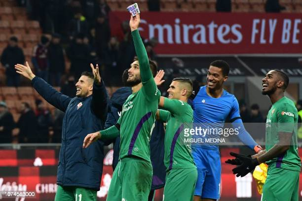 Fiorentina's Argentine defender German Pezzella Fiorentina's French goalkeeper Alban Lafont and teammates acknowledge the public at the end of the...