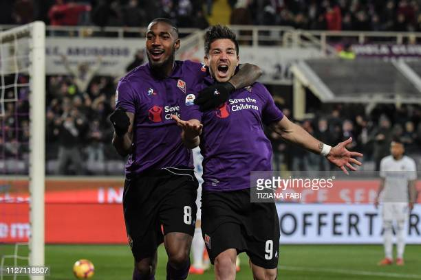 Fiorentina's Argentine forward Giovanni Simeone and Fiorentina's Brazilian midfielder Gerson celebrate after Inter scored an own goal during the...