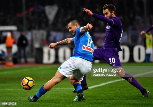 Fiorentina's Argentinian defender German Pezzella fights for the ball with Napoli's Slovakian midfielder Marek Hamsik during the Italian Serie A...