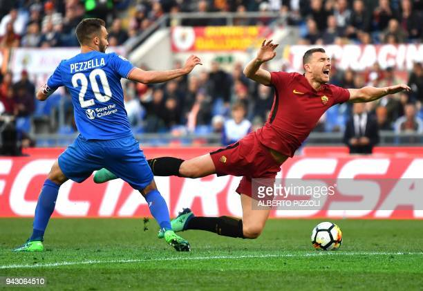 Fiorentina's Argentinian defender German Pezzella fights for the ball with Roma's forward from Bosnia ed Erzegovina Edin Dzeko during the Italian...