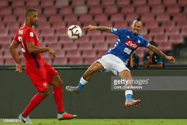 Fiorentina's Brazilian defender Vitor Hugo and Napoli's Slovak midfielder Marek Hamsik go for the ball during the Italian Serie A football match...