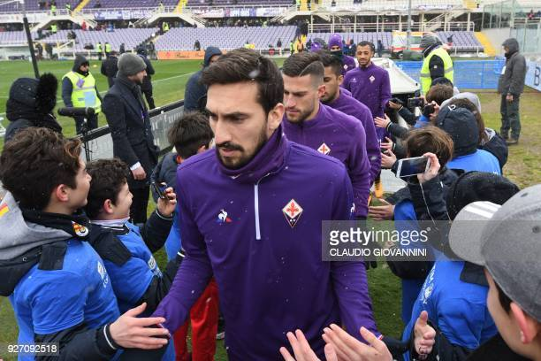 Fiorentina's captain Davide Astori and teammates enter the pitch on February 25 2018 before the Italian Seria A football match Fiorentina vs Chievo...
