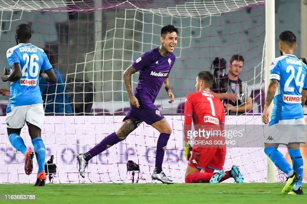 Fiorentina's Chilean midfielder Erick Pulgar celebrates after scoring a penalty past Napoli's Italian goalkeeper Alex Meret during the Italian Serie...