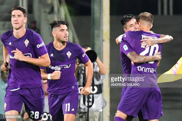 Fiorentina's Chilean midfielder Erick Pulgar celebrates with Fiorentina's Argentinian defender German Pezzella after scoring a penalty during the...