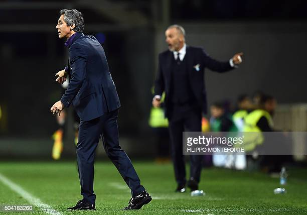Fiorentina's coach from Portugal Paulo Sousa LO and Lazio's coach from Italy Stefano Pioli give instructions to the players during the Italian Serie...