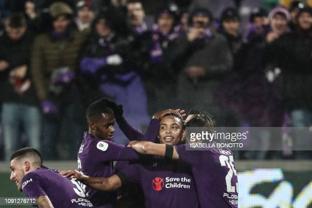 Fiorentina's Colombian forward Luis Muriel celebrates with teammates after scoring during the Italian Tim Cup round of eight football match...
