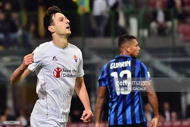 Fiorentina's Croatian forward Nikola Kalinic celebrates after scoring a goal during the Serie A football match between Inter Milan and Fiorentina at...