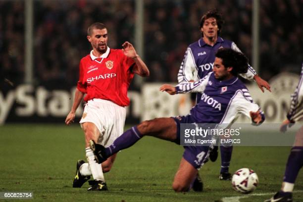 Fiorentina's Daniele Adani dives to try and block the pass from Manchester United's Roy Keane