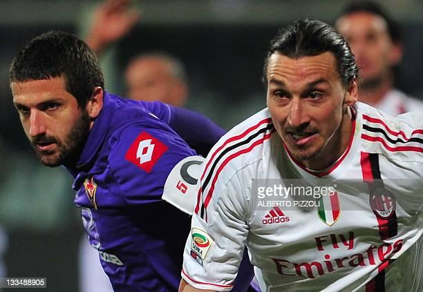 Fiorentina's defender Alessandro Gamberini vies for the ball with AC Milan's Swedish forward Zlatan Ibrahimovic during the Italian A series football...