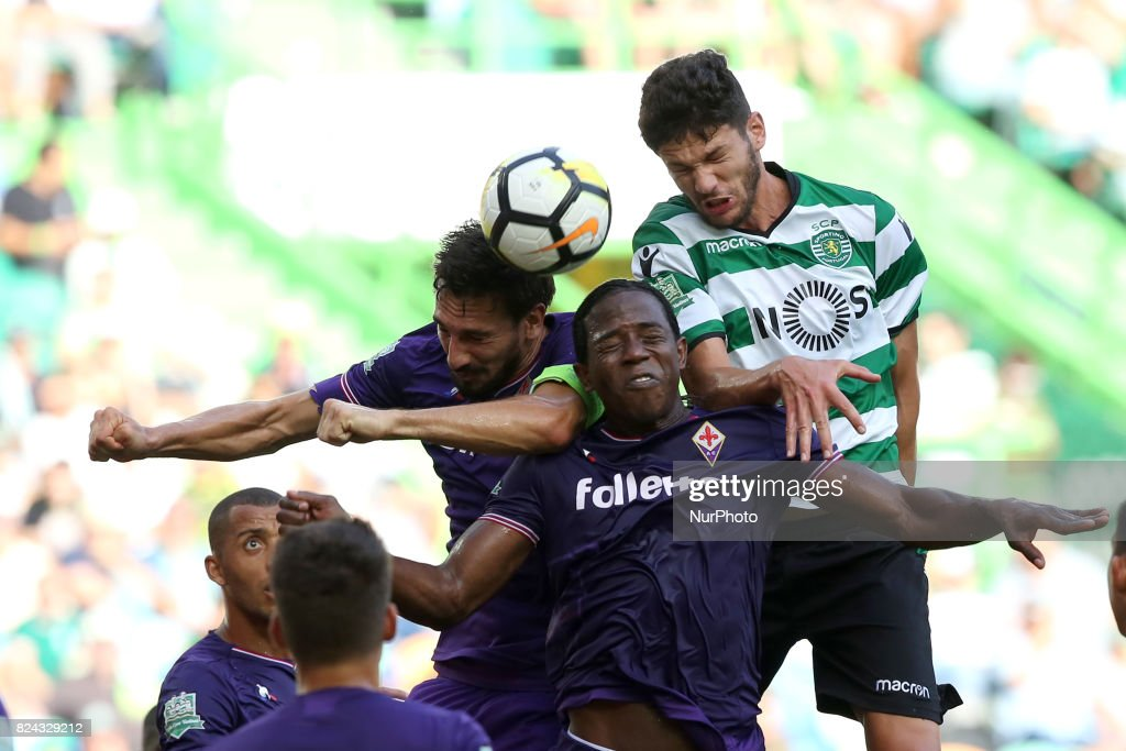 Fiorentina's defender Davide Astori (L) heads the ball with Fiorentina's defender Sanchez Moreno (C ) and Sporting's Portuguese defender Tobias Figueiredo (R ) during the Trophy Five Violins 2017 final football match Sporting CP vs ACF Fiorentina at Alvadade stadium in Lisbon, Portugal on July 29, 2017.