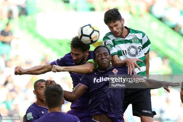 Fiorentina's defender Davide Astori heads the ball with Fiorentina's defender Sanchez Moreno and Sporting's Portuguese defender Tobias Figueiredo...