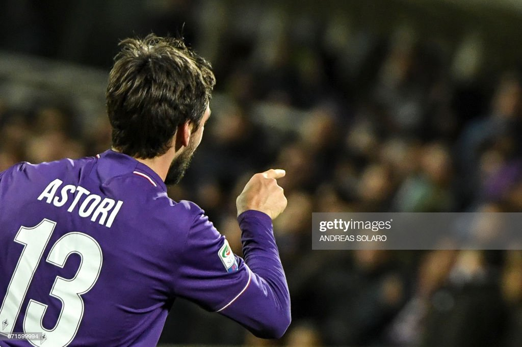 Fiorentina's defender from Italy Davide Astori celebrates after scoring during the Italian Serie A football match Fiorentina vs Inter Milan, on April 22, 2017 at Florence's 'Artemio Franchi' communal stadium. /