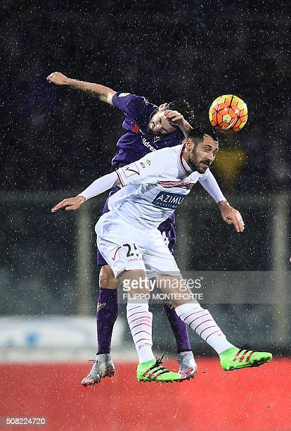 TOPSHOT Fiorentina's defender from Italy Davide Astori vies with Carpi's forward from Italy Matteo Mancosu during the Italian Serie A football match...