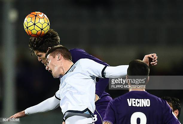 Fiorentina's defender from Spain Marcos Alonso Mendoza heads the ball with Lazio's midfielder from Serbia Sergej MilinkovicSavic during the Italian...