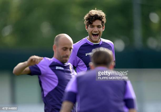 Fiorentina's defender from Spain Marcos Alonso Mendoza smiles during a training session on the eve of the UEFA Europa League semi final second leg...
