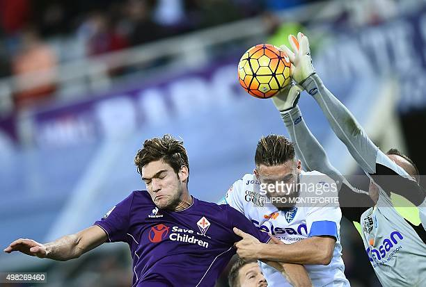 Fiorentina's defender from Spain Marcos Alonso Mendoza vies with Empoli's defender from Italy Lorenzo Tonelli and Empoli's goalkeeper from Poland...