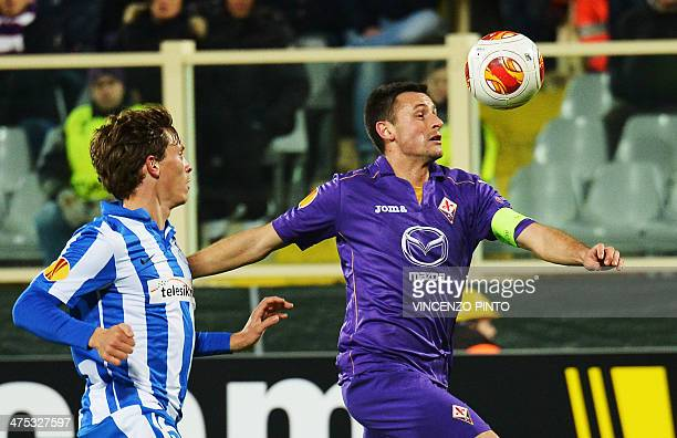 Fiorentina's defender Manuel Pasqual vies with Esbjerg's midfielder Ryan Laursen during the round of 32 UEFA Europa League football match between...