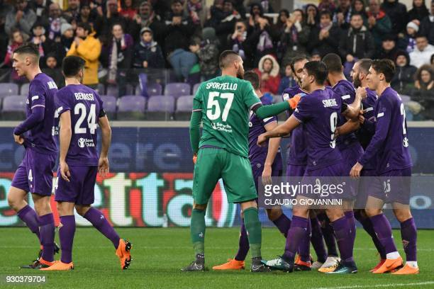Fiorentina's defender Vitor Hugo celebrates with teammates after scoring on March 11 2018 during the Italian Serie A football match Fiorentina vs...