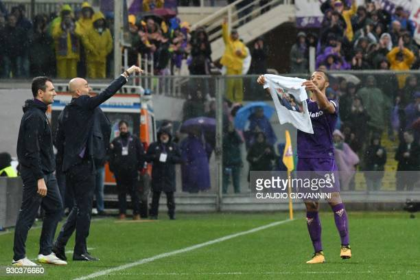 Fiorentina's defender Vitor Hugo pays tribute to late Fiorentina's captain Davide Astori after scoring on March 11 2018 during the Italian Serie A...