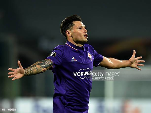 Fiorentina's forward from Argentina Mauro Zarate celebrates after scoring during the Europa League football match between Fiorentina and Qarabag at...
