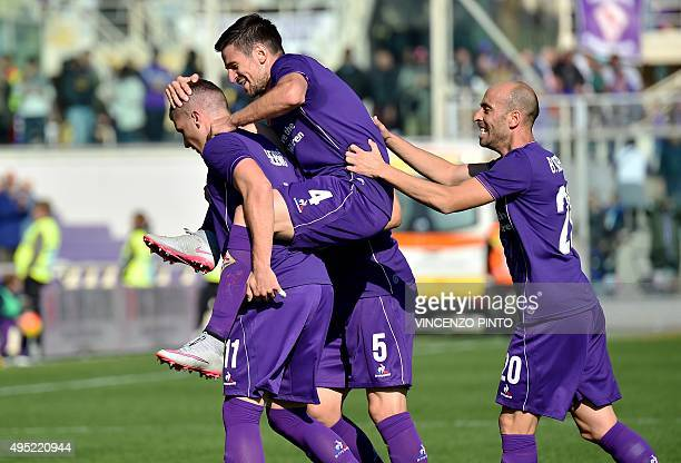 Fiorentina's forward from Croatia Ante Rebic celebrates with teammates after scoring during the Italian Serie A football match Fiorentina vs...