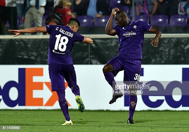 Fiorentina's forward from Senegal Khouma Babacar celebrates with teammate Carlos Salcedo after scoring during the Europa League football match...