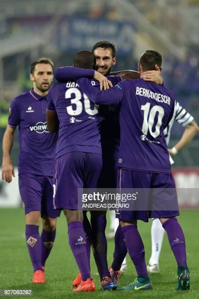 Fiorentina's forward from Senegal Khouma Babacar celebrates with Fiorentina's defender Davide Astori and forward Federico Bernardeschi after scoring...