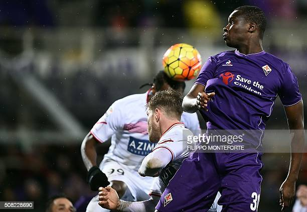 Fiorentina's forward from Senegal Khouma Babacar jumps for the ball with Carpi's forward from Nigeria Jerry Mbakogu during the Italian Serie A...
