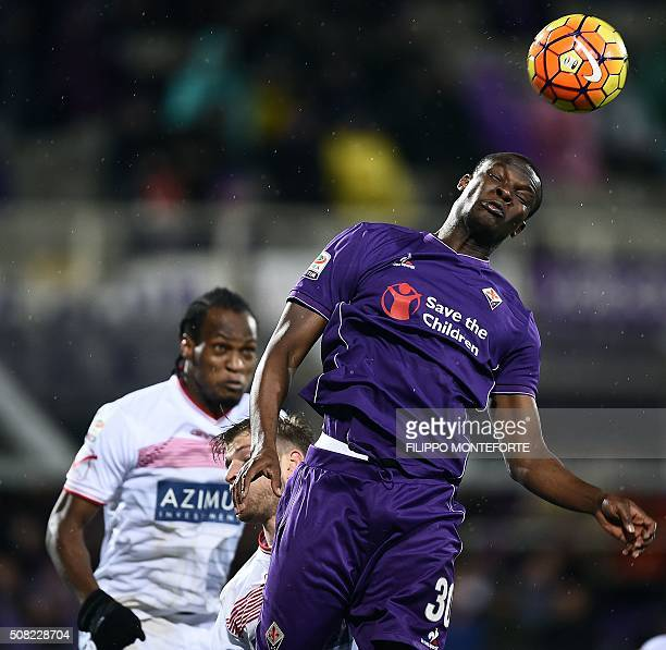 Fiorentina's forward from Senegal Khouma Babacar jumps for the ballwith Carpi's forward from Nigeria Jerry Mbakogu during the Italian Serie A...