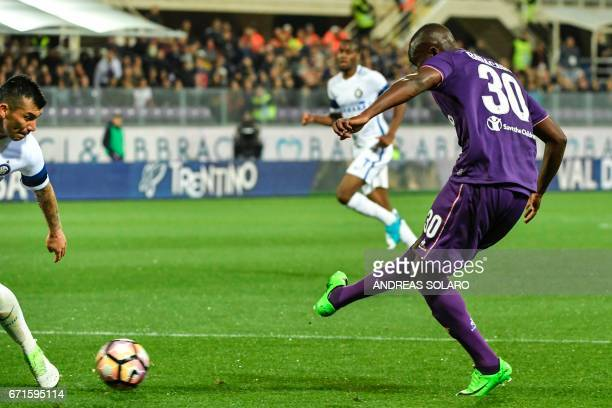 Fiorentina's forward from Senegal Khouma Babacar shoots and scores during the Italian Serie A football match Fiorentina vs Inter Milan on April 22...