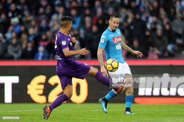 STADIUM NAPLES CAMPANIA ITALY Fiorentina's French defender Vincent Laurini fights for the ball with Napoli's Slovakian midfielder Marek Hamsik during...