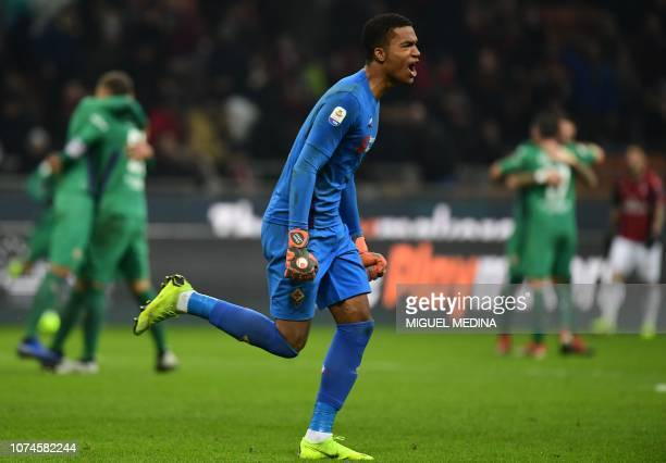Fiorentina's French goalkeeper Alban Lafont celebrates at the end of the Italian Serie A Football match AC Milan vs Fiorentina on December 22 2018 at...