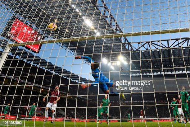 Fiorentina's French goalkeeper Alban Lafont deflects a headshot from AC Milan's Swiss defender Ricardo Rodriguez during the Italian Serie A Football...