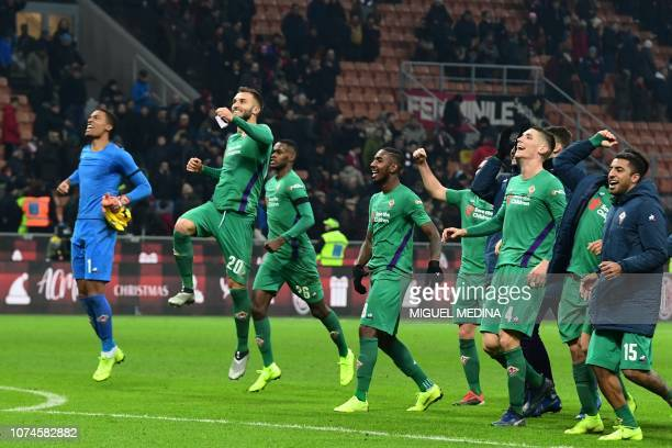 Fiorentina's French goalkeeper Alban Lafont Fiorentina's Argentine defender German Pezzella and teammates celebrate at the end of the Italian Serie A...