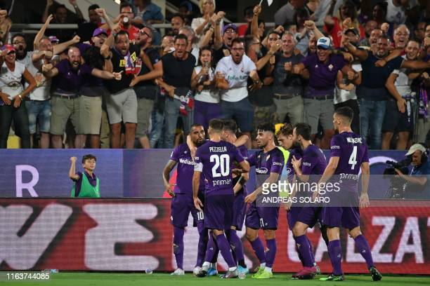 Fiorentina's Ghanaian forward KevinPrince Boateng celebrates with teammates after scoring during the Italian Serie A football match Fiorentina vs...