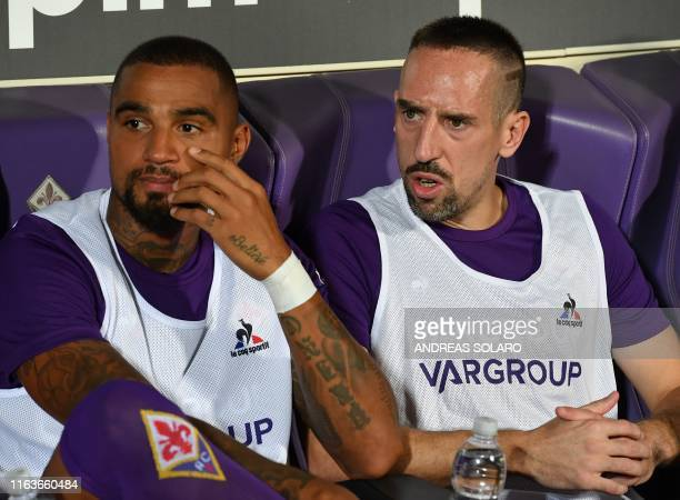 Fiorentina's Ghanaian forward KevinPrince Boateng Fiorentina's French forward Franck Ribery attend on the substitutes' bench the Italian Serie A...