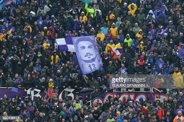Fiorentina's hold a portrait of late captain Davide Astori during the Italian Serie A football match Fiorentina vs Benevento on March 11 2018 at the...