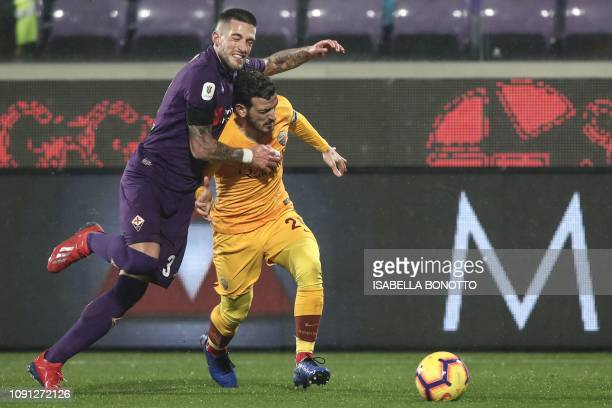 Fiorentina's Italian defender Cristiano Biraghi collides with AS Roma Italian midfielder Alessandro Florenzi during the Italian Tim Cup round of...