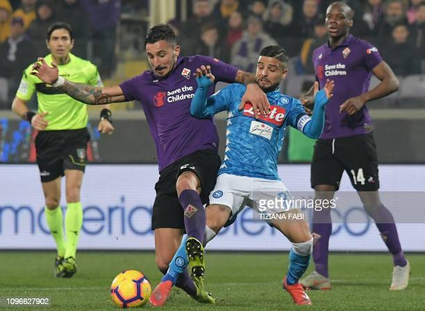 Fiorentina's Italian defender Federico Ceccherini and Napoli's Italian forward Lorenzo Insigne go for the ball during the Italian Serie A football...