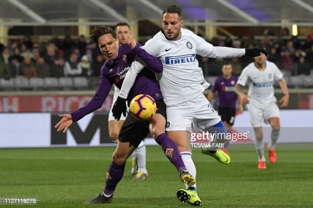 Fiorentina's Italian forward Federico Chiesa and Inter Milan's Italian defender Danilo D'Ambrosio go for the ball during the Italian Serie A football...