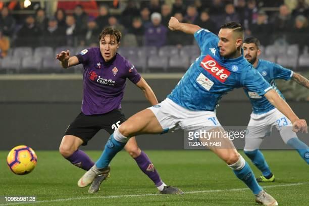Fiorentina's Italian forward Federico Chiesa and Napoli's Serbian defender Nikola Maksimovic go for the ball during the Italian Serie A football...