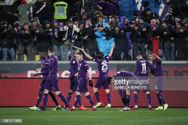 Fiorentina's Italian forward Federico Chiesa celebrates with fans after opening the scoring during the Italian Tim Cup round of eight football match...