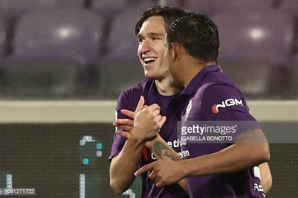 Fiorentina's Italian forward Federico Chiesa celebrates with Fiorentina's Colombian forward Luis Muriel after scoring during the Italian Tim Cup...