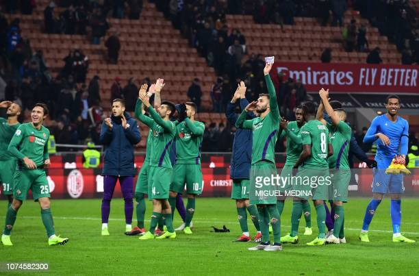 Fiorentina's Italian forward Federico Chiesa Fiorentina's French goalkeeper Alban Lafont and teammates acknowledge the public at the end of the...