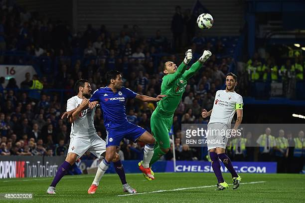 Fiorentina's Italian goalkeeper Luigi Sepe punches the ball away from Chelsea's Colombian striker Radamel Falcao during the preseason friendly...