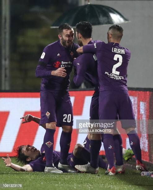Fiorentina's Italian midfielder Marco Benassi celebrates with Fiorentina's Argentine defender German Pezzella , Fiorentina's French defender Vincent...