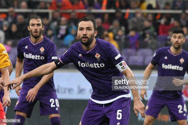 Fiorentina's midfielder and new captain Milan Badelj looks on during the Italian Serie A football match Fiorentina vs Benevento on March 11 2018 at...